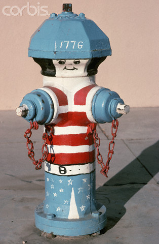 ca. August 1976, Burbank, California, USA --- Painted Fire Hydrant at America's Bicentennial --- Image by © Henry Diltz/Corbis